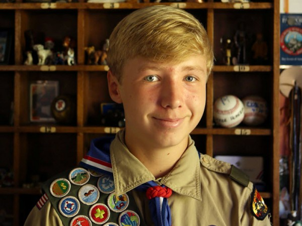 Tucker Cullen showcases his various badges earned through the Boy Scouts at his home in Petaluma. (CONNER JAY / The Press Democrat)